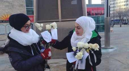 WHITE FLOWERS OFFER CANADA MUSLIMS PEACE