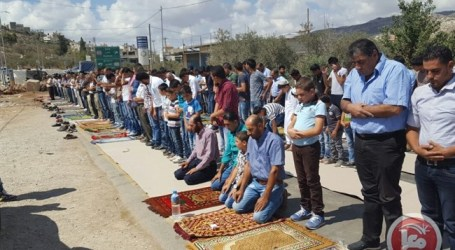Palestinians Perform Friday Prayers at Beita Entrance to Protest Road Closures