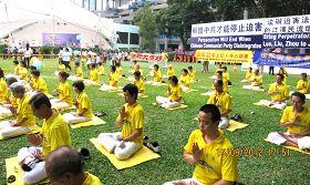 新加坡法轮功学员在芳林公园举行集会活动,抗议迫害元凶周永康