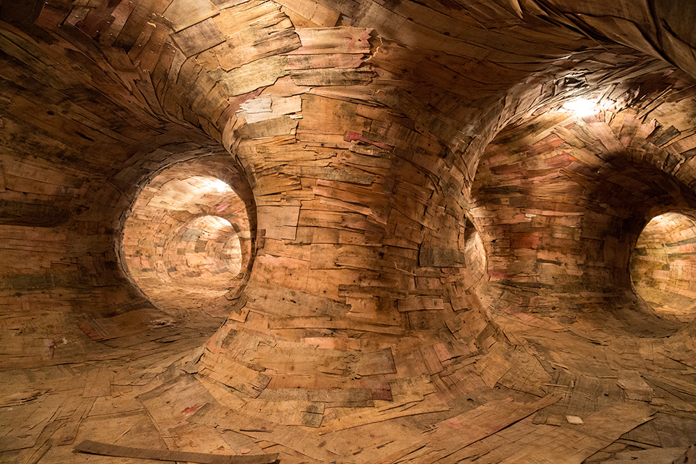 Artist Henrique Oliveira Constructs a Cavernous Network of Repurposed Wood Tunnels at MAC USP wood installation architecture