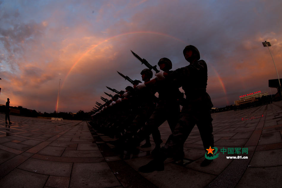 Chinese soldiers conduct training at night for V-Day parade
