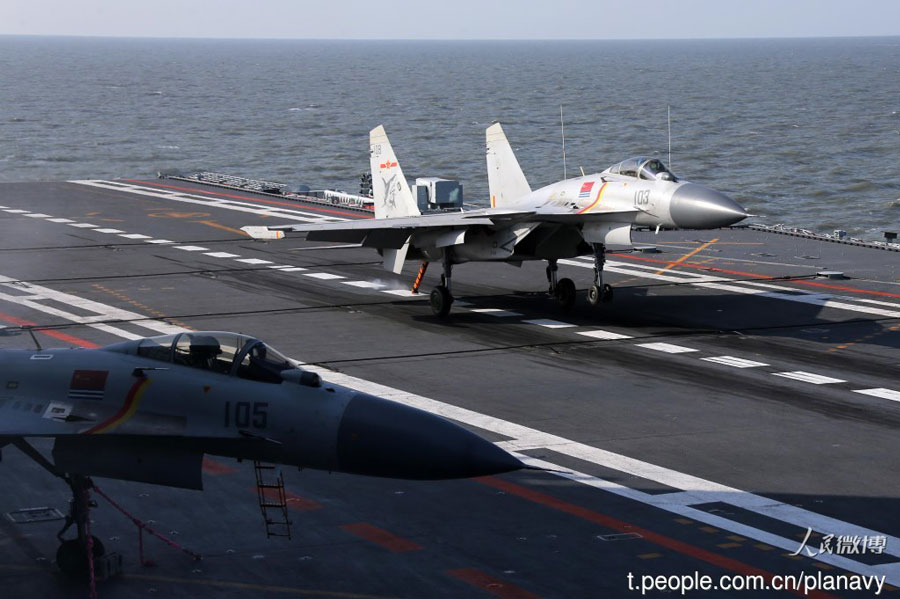 J-15 carrier-based fighters conduct training on the Liaoning