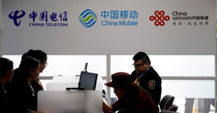 In sudden reversal, NYSE says will not delist three Chinese telcos