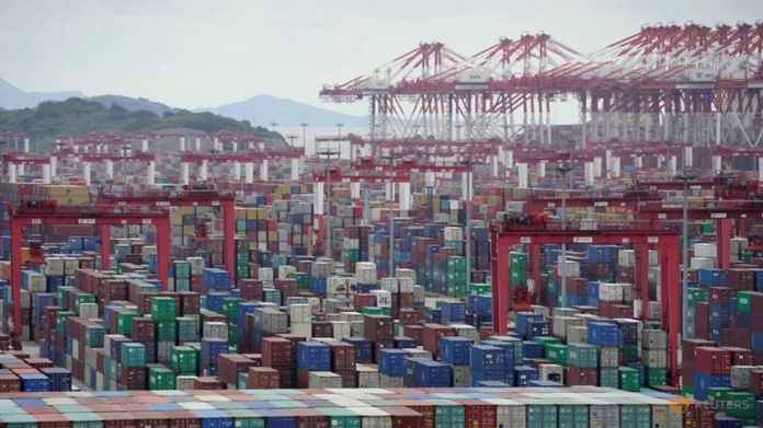 China, New Zealand ink trade deal as Beijing calls for reduced global barriers