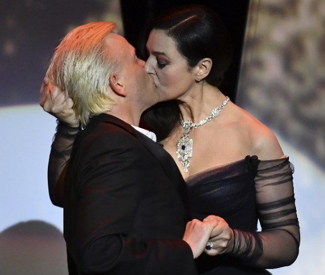 Italian Actress And Master Of Ceremonies Monica Bellucci R And French Comedian Alex Lutz