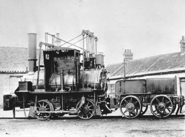 Post c1882 photograph of Lyon showing its driver's shelter and replacement valve motion, together with its replacement tender.