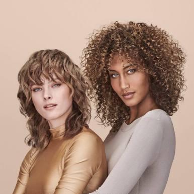 Romy and Arshea wear Enchant