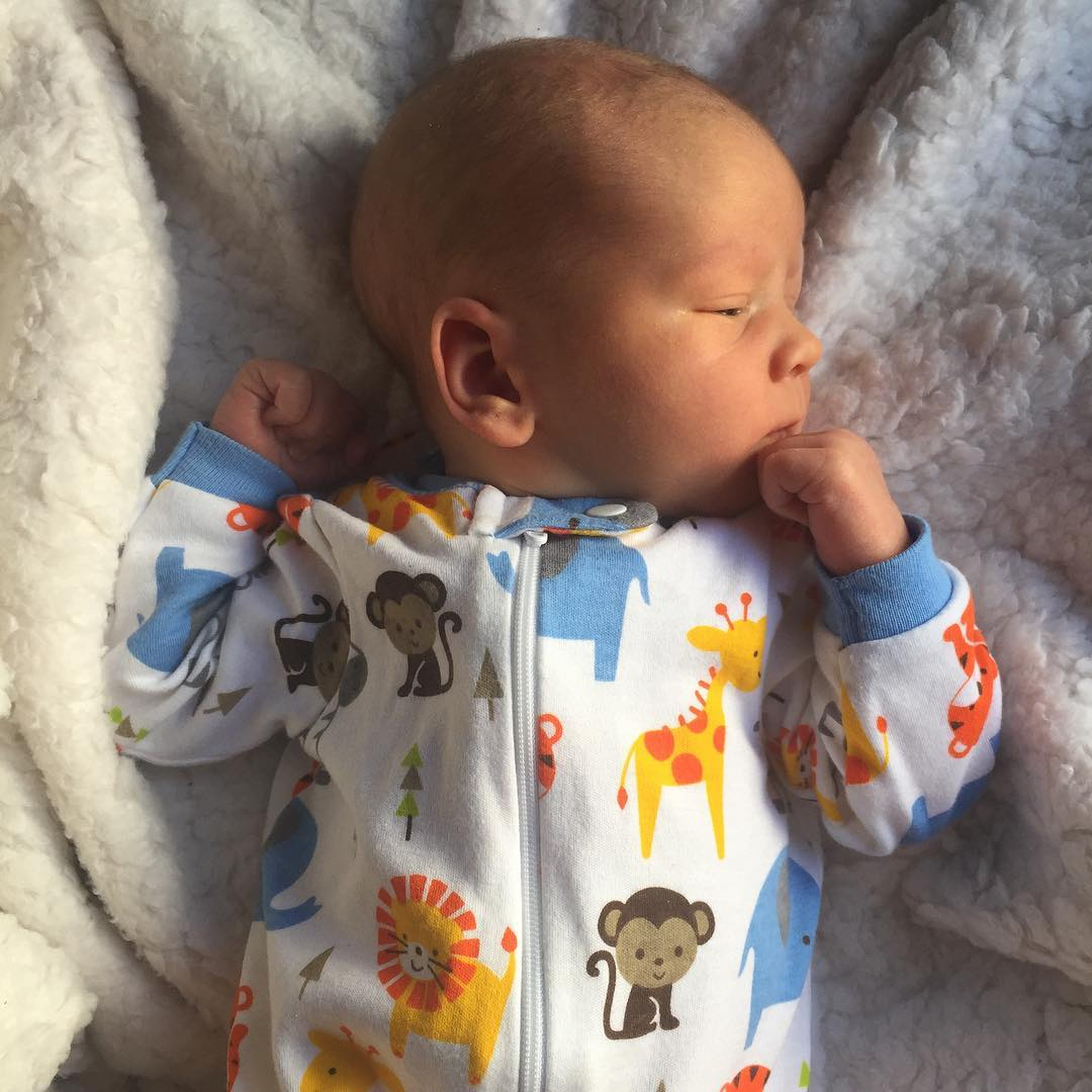 Two weeks old and looking pensive (he was going for thoughtful). Seems like everyone is on the mend in our house