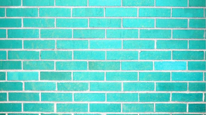 A photo of wall with turquoise bricks