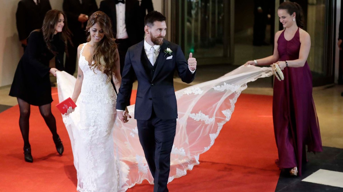 Newlywed Lionel Messi flashes a thumbs as he and his bride Antonella Roccuzzo come out on to a red carpet to pose for photographers, after tying the knot in Rosario, Argentina, Friday, June 30, 2017. About 250 guests, including teammates and former teammates of the Barcelona star, attended the highly anticipated ceremony.(AP Photo/Victor R. Caivano)