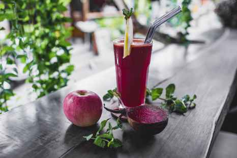 natural apple and beetroot smoothie served on table of resort cafe