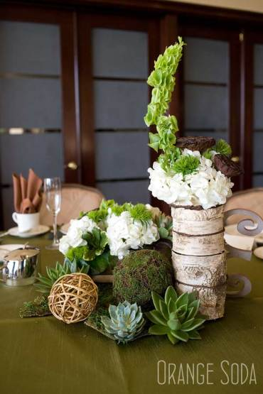 Rustic Centerpieces with wood, moss, succulents and flowers.