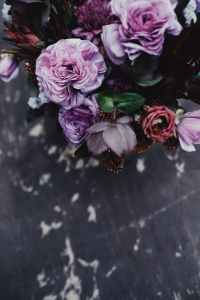 pink and purple flowers on black wooden table