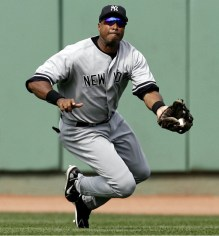 New York Yankees center fielder Bernie Williams makes a sliding catch on a ball hit by Boston Red Sox's Javy Lopez during the fifth inning of major league baseball at Fenway Park in Boston Saturday, Aug. 19, 2006. (AP Photo/Winslow Townson)