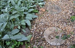 Stepping stones with the imprints of grandchildren's hands and feet.