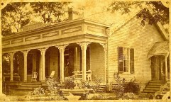 Ivy Cottage, possibly in the late 1870s. Julia and maybe one of her sons stand in the doorway.