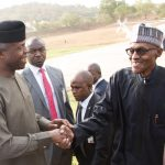 R-L; President Muhammadu Buhari being welcome by the Vice President Yemi Osinbajo