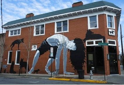 Atlanta artist Matt Hafner enlivens a wall on Greenwood Avenue.