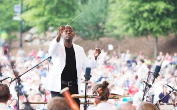 Conductor Joseph Young leads the ASO in Piedmont Park. Photo: Jeff Rothman / 2014