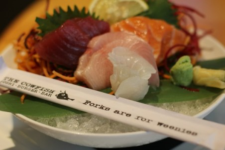 At Cowfish, the sashimi is served on rice.