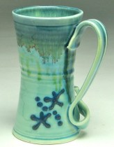 Tall coffee cup by Gabriel Kline at ClayWorks in the Odyssey Center.