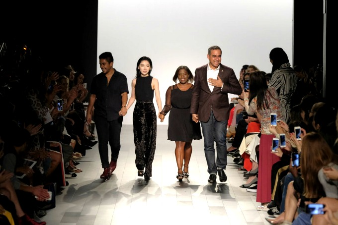 Designer Bibhu Mohapatra (right) walks the runway at the conclusion of his New York Fashion Week show.