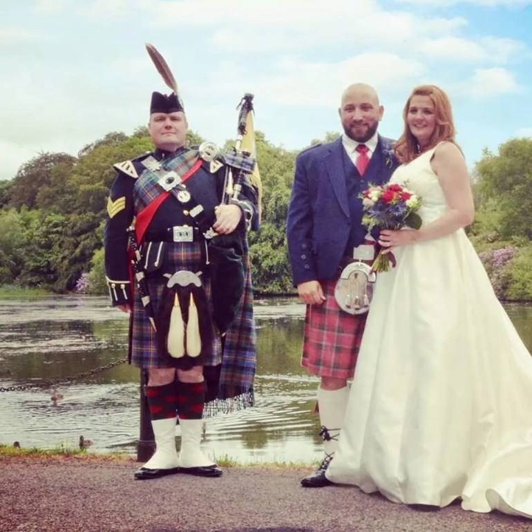 Andy the Piper with wedding couple