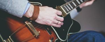 A guitarist practices