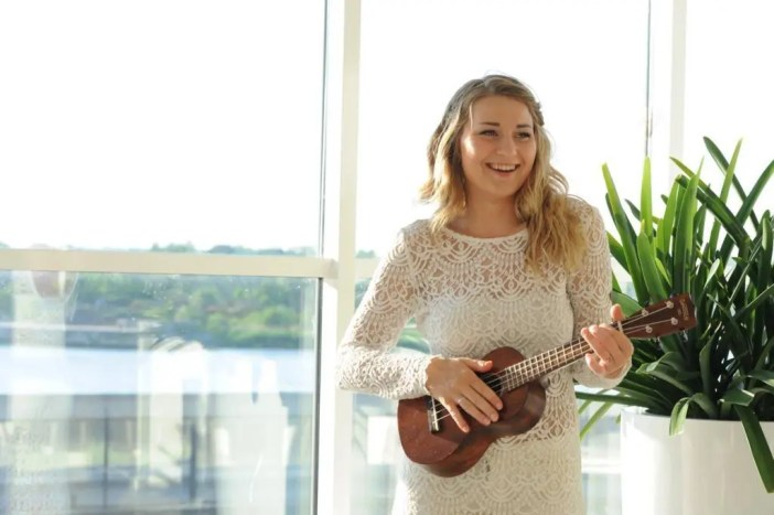 Bride with ukulele performing as a wedding musician at her own wedding!
