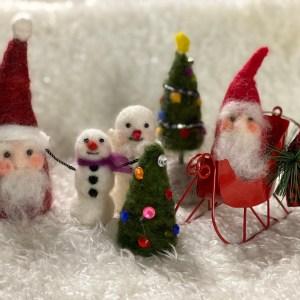 miniature needle-felted santa and snowmen