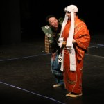 2 performers on a stage performing kyogen