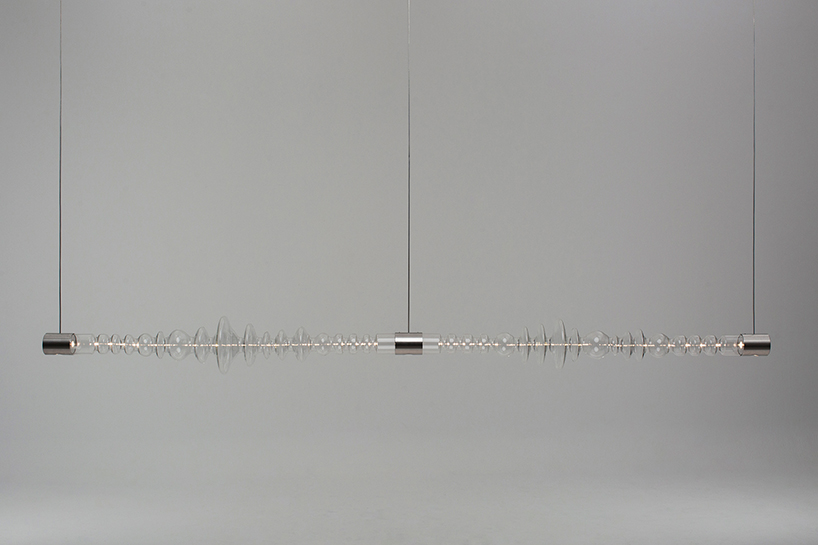 filamento, an over 1-meter long glass lighting sculpture designed by mayice designboom