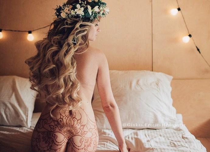 Erotic Mehndi model sitting on bed