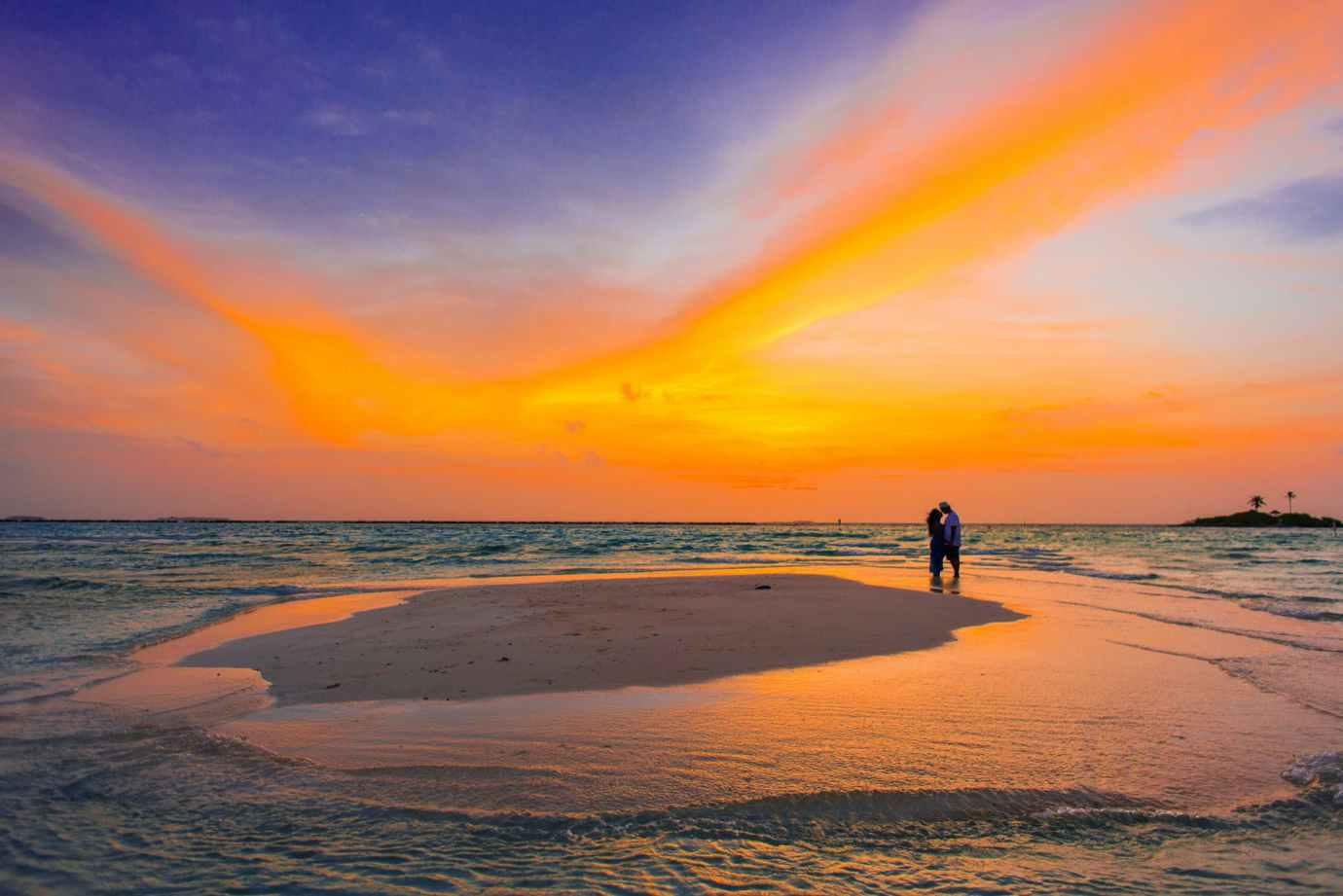 two people standing near seashore