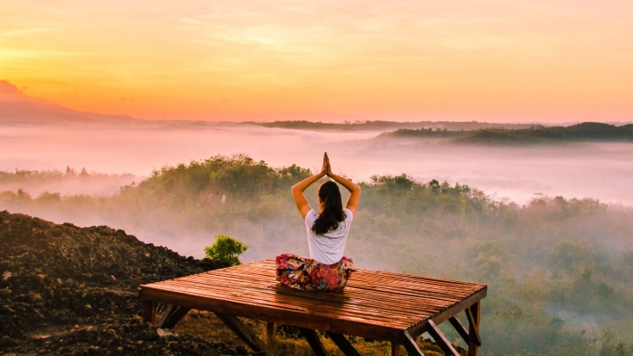 Morning yoga on a wooden platform