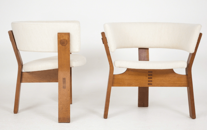 Pair of oak armchairs with three legged base, seat and back upholstered. Designed by Steen Østergaard