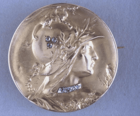 Hollow gold brooch with a profile head of Minerva by Louis Armand Rault
