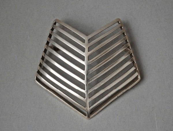Silver brooch, with ten v-shaped bars joined in centre designed by Nanna Ditzel