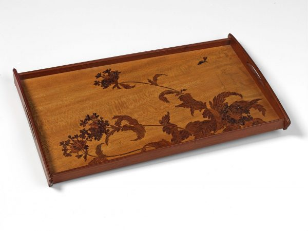 Tray (1899-1900) Wooden marquetry tray the design is of an asymmetric floral spray, with a bee on the top right. Designed by Louis Majorelle