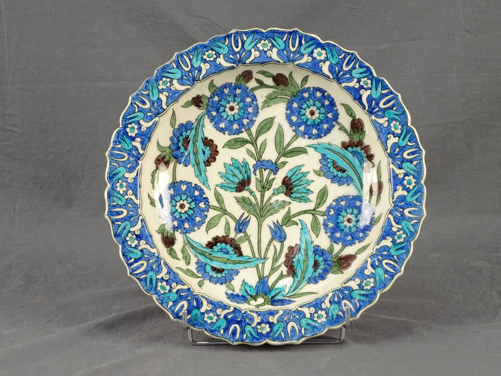 Multi-lobed earthenware hollow dish decorated with a large bouquet of flowers designed by Edmond Lachenal
