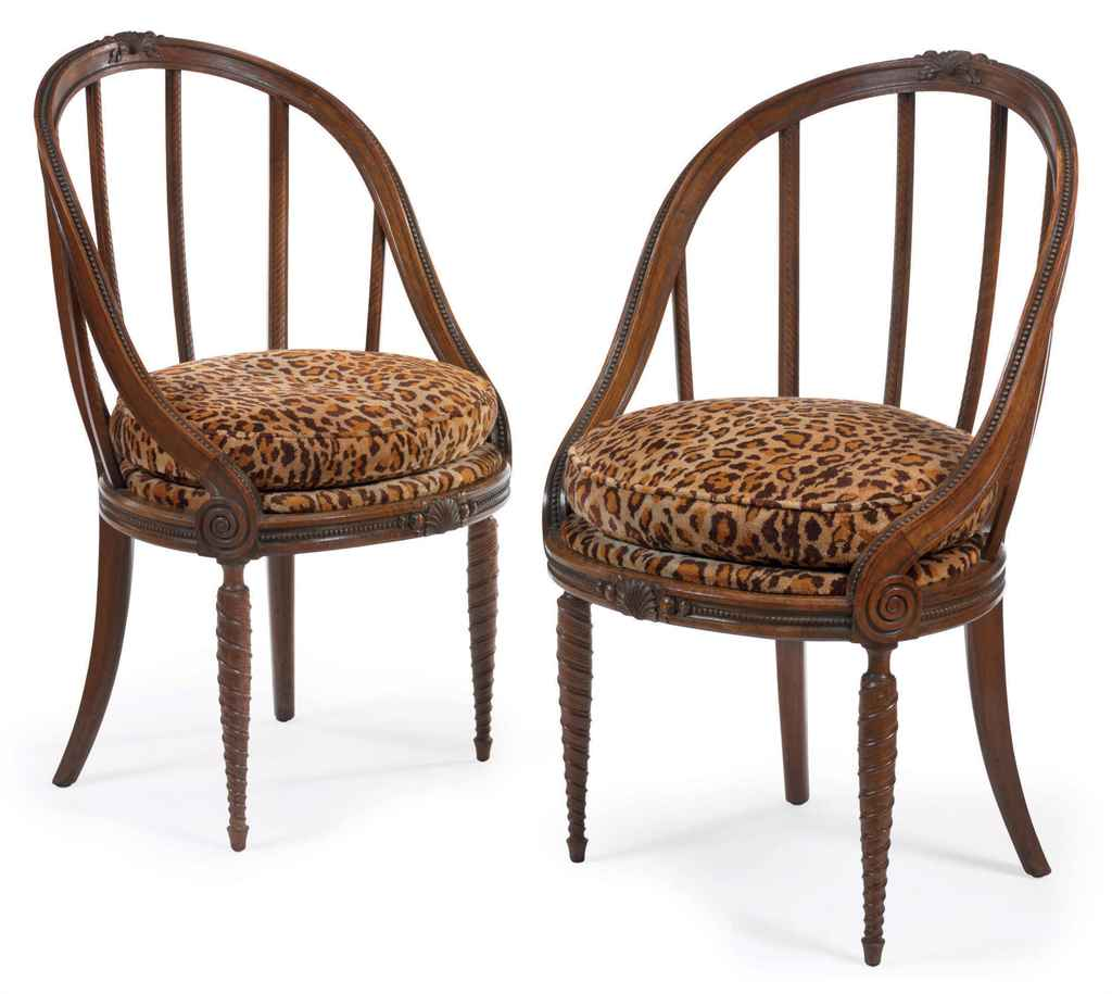 A pair of upholstered walnut 'Gondola' armchairs, circa 1925 by André Groult.