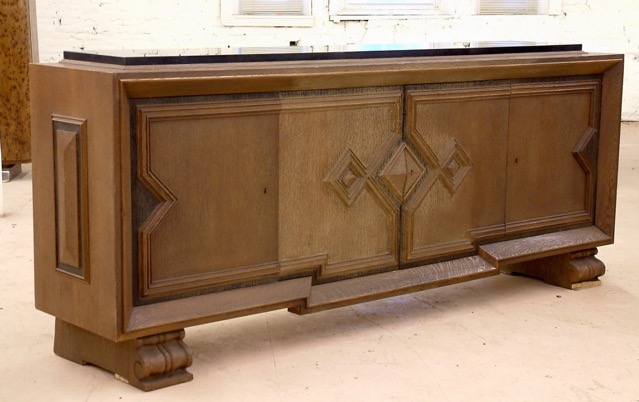 French Forties Art Deco cabinet in sculpted, limed oak. Circa 1945 designed by Jean-Charles Moreux