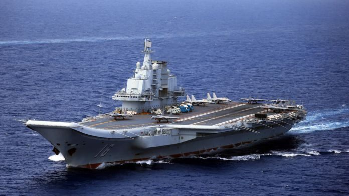 China aircraft carrier fleet passes near rival Taiwan; says American and Japanese ships followed