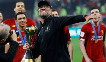 Liverpool lift the FIFA Club World Cup trophy after a 1-0 victory over Flamengo