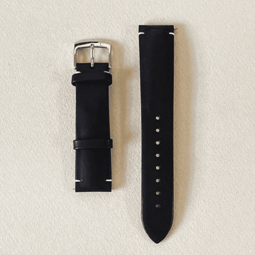 Genuine calf leather, vegetable tanned black featuring a tongue buckle and quick release pin
