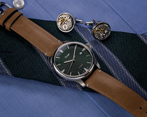 Swiss-made watch featuring a green dial and Eta 2824-2 automatic movement with a genuine leather strap set atop a tie beside cuff links