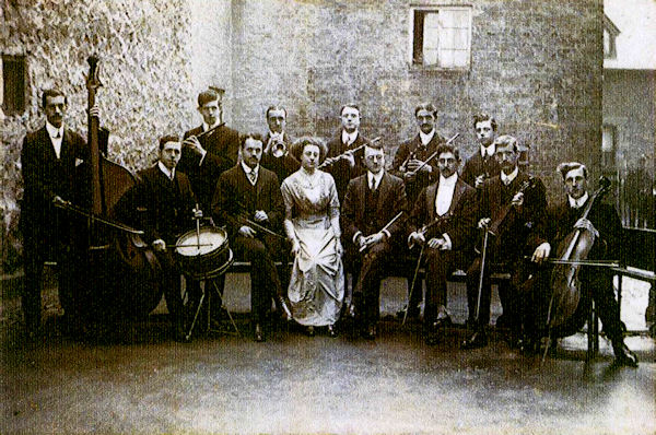 Enderby Band (aka Village Orchestra) outside the National School in 1900-1910.