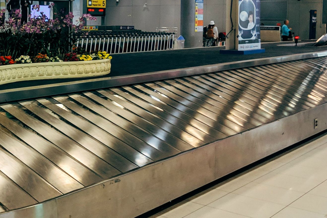 a-luggage-conveyor-inside-airport-3693017