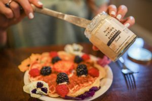 Protein Waffles with Caramel Ghee butter, fruit, and edible flowers