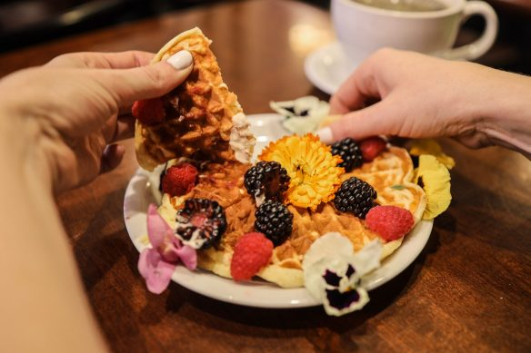 Viking Waffles with edible flowers, Viking Butter, and fresh berries.